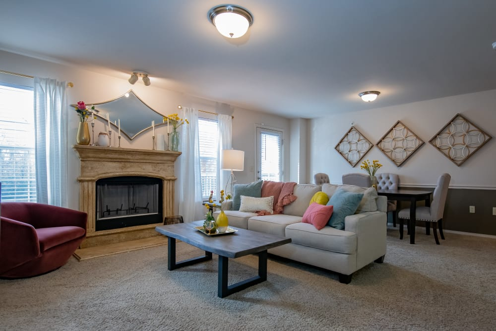 Spacious living room with fireplace at Nickel Creek Apartments in Tulsa, Oklahoma