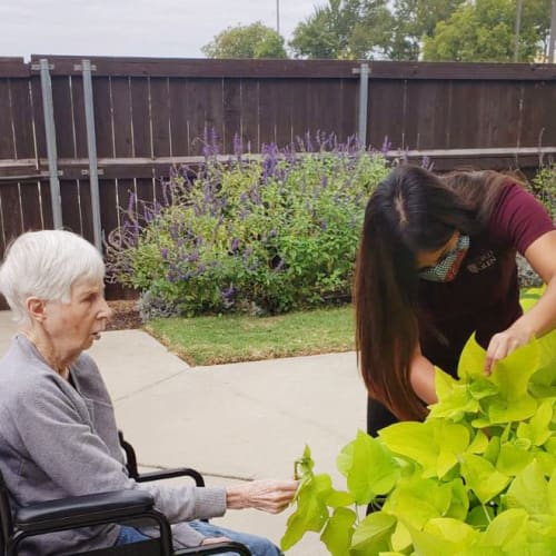 A happy resident outside of Oxford Glen Memory Care at Sachse in Sachse, Texas