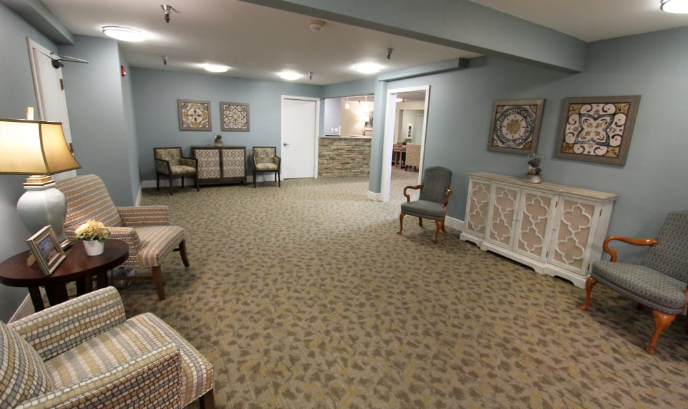 Lobby entrance with seating at The Village Senior Living in Tacoma, WA
