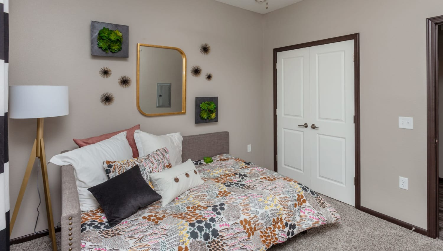 Bedroom with a ceiling fan at Autumn Ridge in Waukee, Iowa