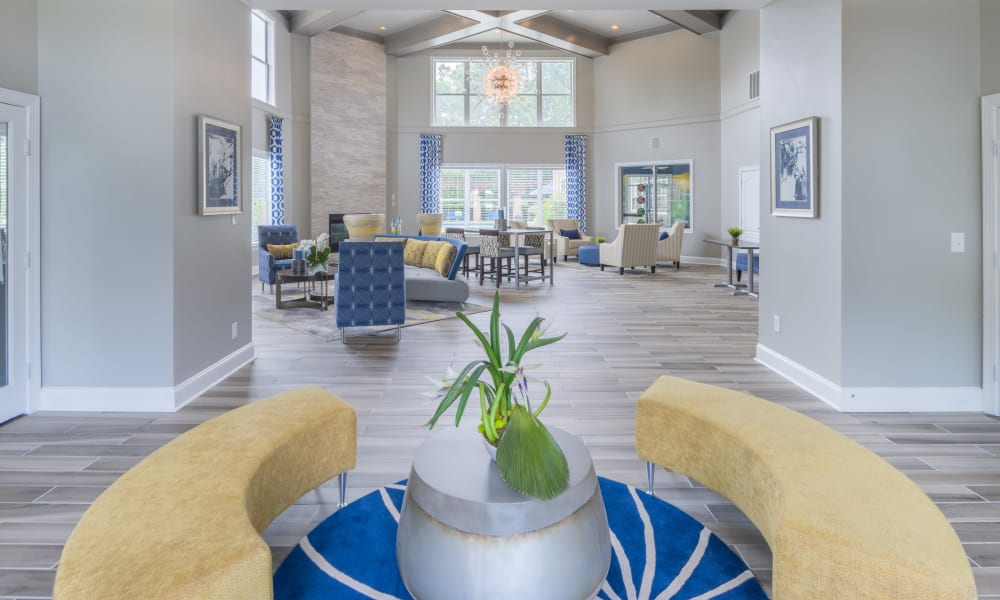 View of the resident clubhouse lounge area from the lobby entrance at The Carling on Frankford in Carrollton, Texas
