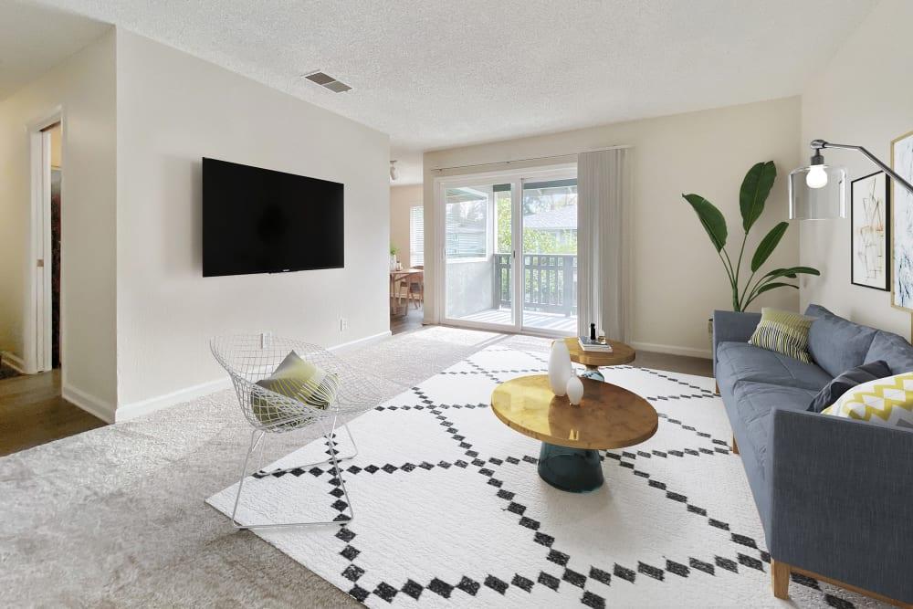 Plush carpeting and natural light filling a model home's living area at Pleasanton Glen Apartment Homes in Pleasanton, California