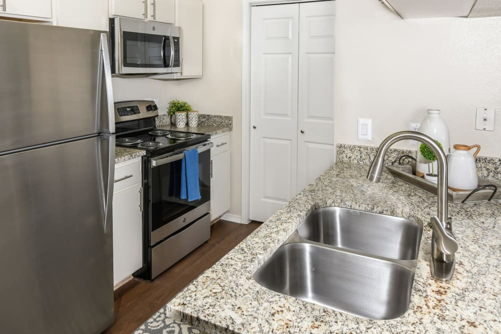 Kitchen at Ballantyne Apartments in Lewisville, Texas