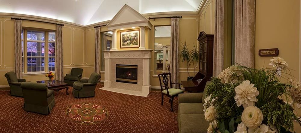 Comfy fireplace at Waltonwood Twelve Oaks senior apartments