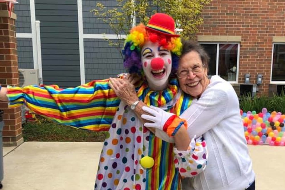 resident smiling with a clown
