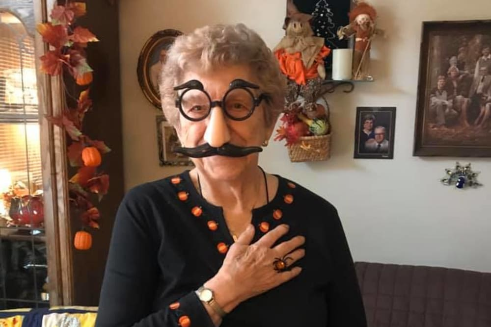 Resident celebrating Halloween with glasses and a mustache at Allouez Sunrise Village in Green Bay, Wisconsin