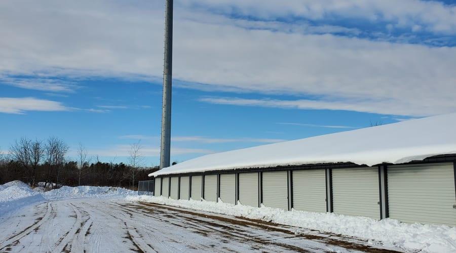 Storage units with white doors and locks at KO Storage of Brainerd in Brainerd, Minnesota