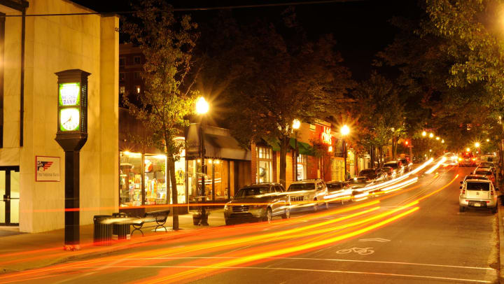 Night traffic along street in State College, PA