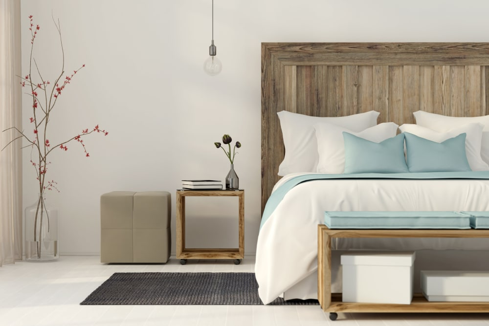 Bedroom with wooden accents at Monarch at Ridge Hill in Yonkers, New York
