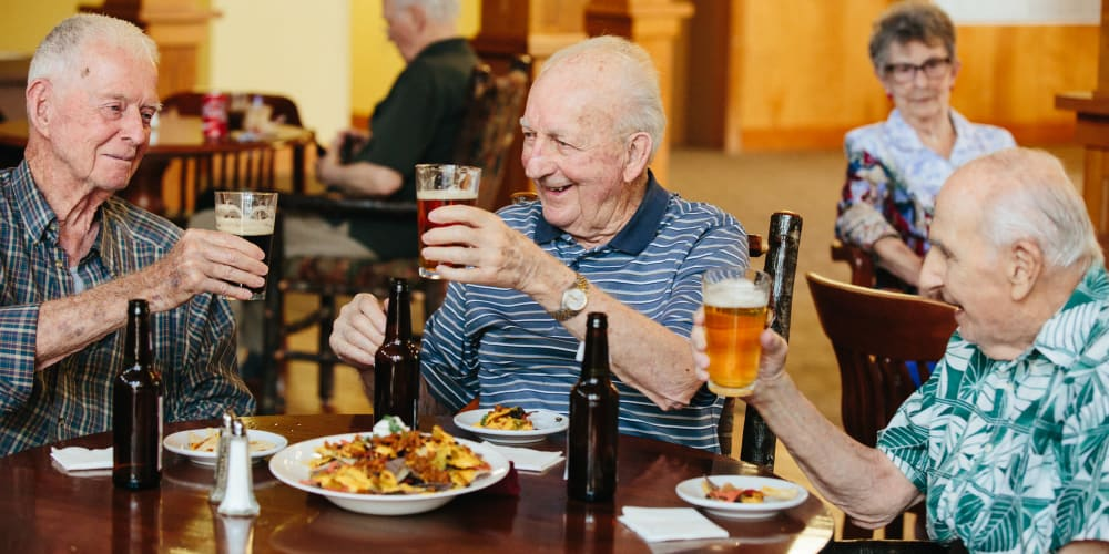 Three residents enjoying some food and drinks at Fancho's at The Springs at Missoula in Missoula, Montana