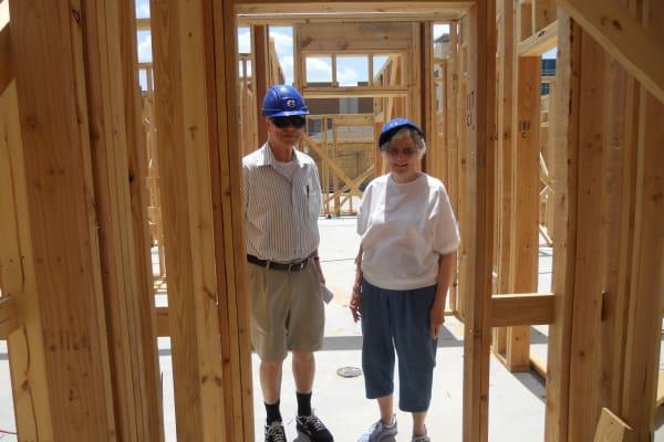 Residents checking construction progress at Ashton Gardens Gracious Retirement Living in Portland, Maine
