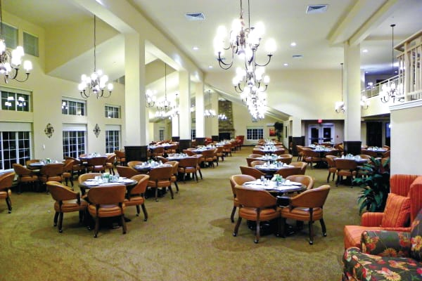 A large dining room at Colonial Gardens Gracious Retirement Living in Beverly, Massachusetts
