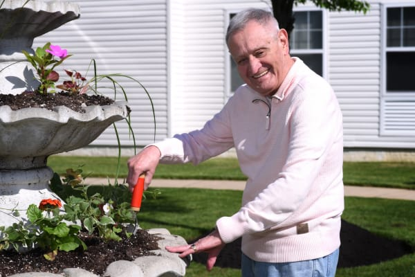 Senior resident enjoying a beautiful day outside at Mattison Crossing at Manalapan Avenue in Freehold, New Jersey