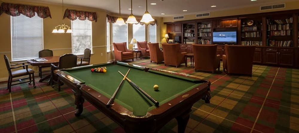 Game room at Waltonwood Twelve Oaks in Novi, MI