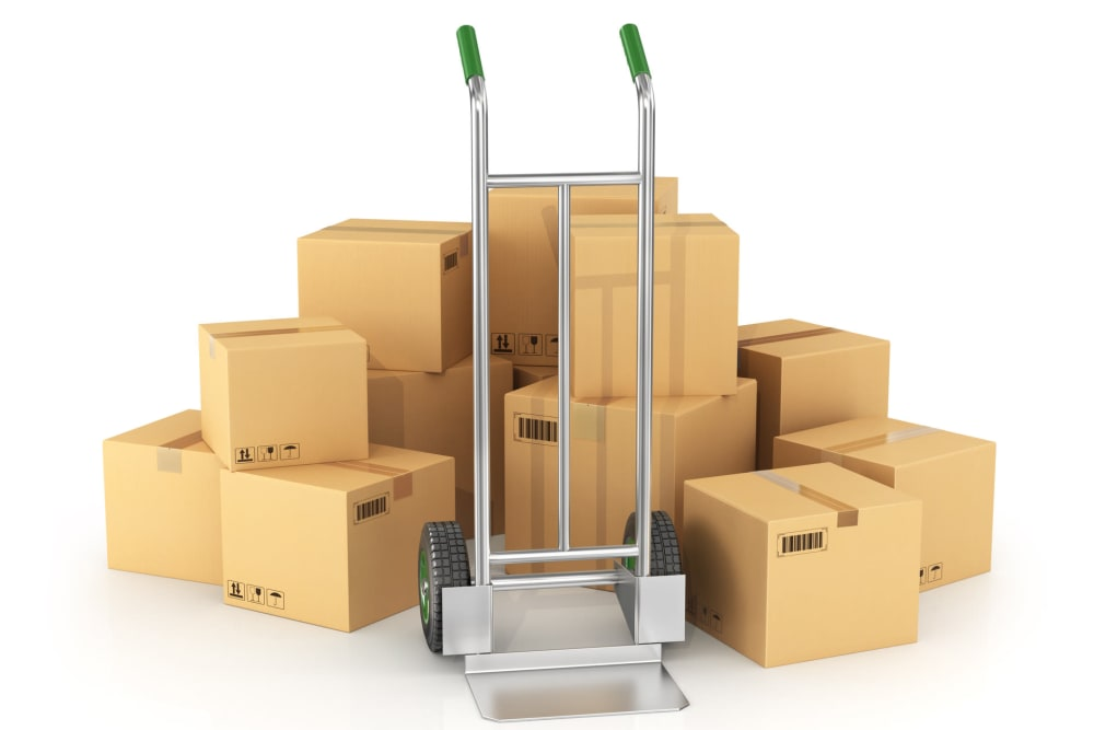 A dolly and boxes available at Dominion Self-Storage in Mesa, Arizona