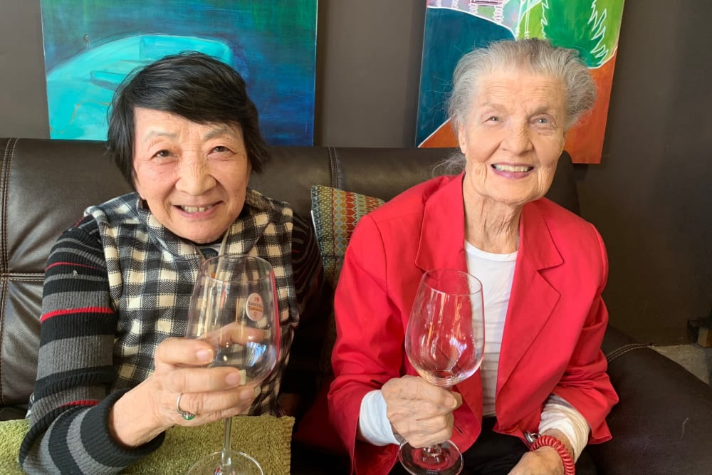 Two ladies enjoying a glass of wine at Merrill Gardens at First Hill