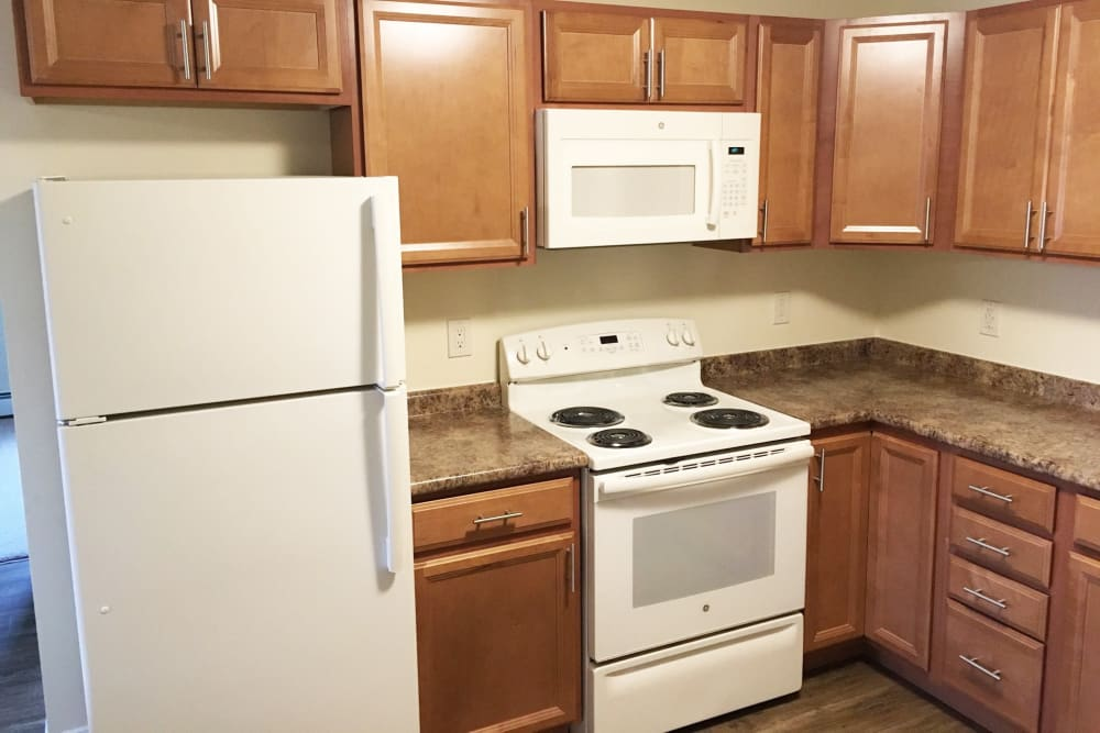 Kitchen with plenty of cabinet space at Hampton Arms Apartments in Hampton, New Hampshire