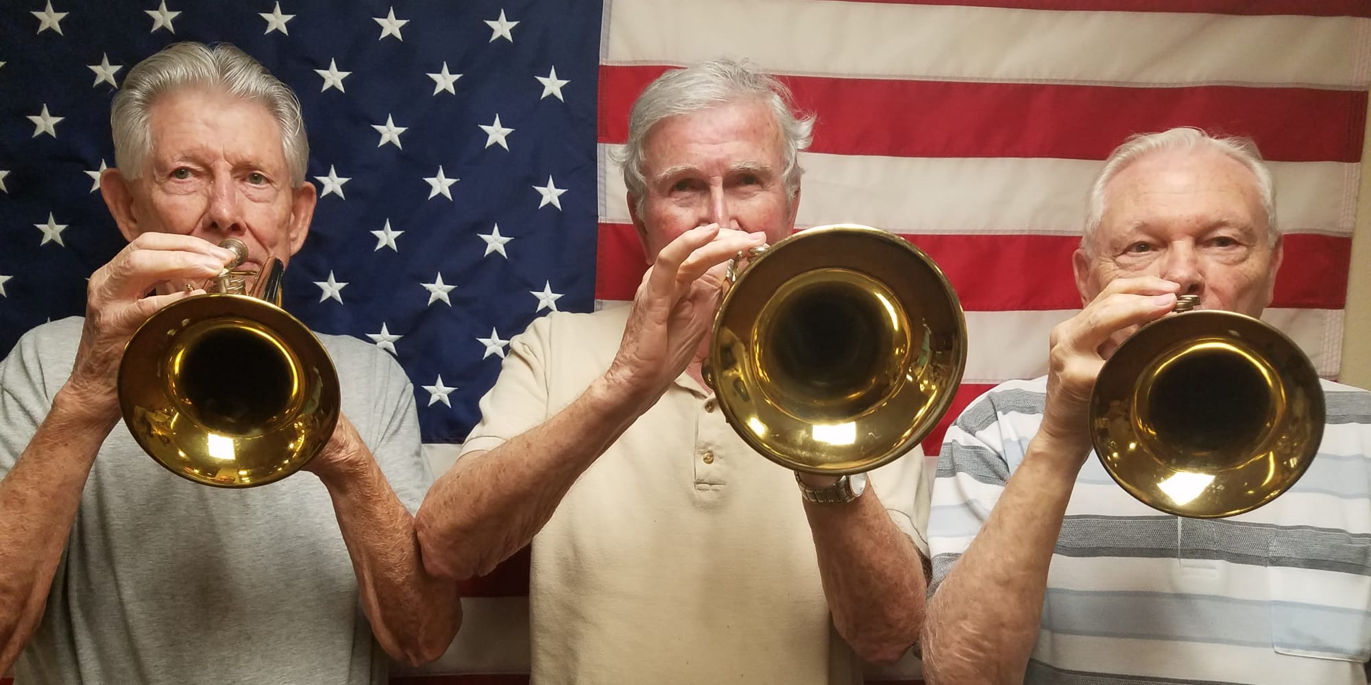Three residents playing trumpets at Chesterfield Heights in Midlothian, Virginia
