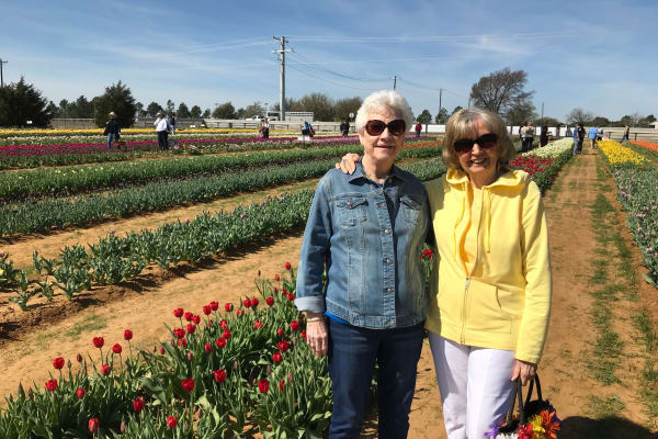 Two residents from Colonial Gardens Gracious Retirement Living in Beverly, Massachusetts in a tulip field