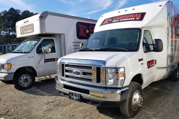 Moving trucks with logo from Cardinal Self Storage - Burlington in Burlington, North Carolina