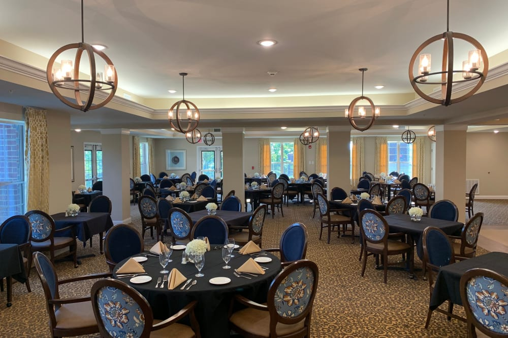 Well decorated dining room tables at Harmony at Brentwood in Brentwood, Tennessee