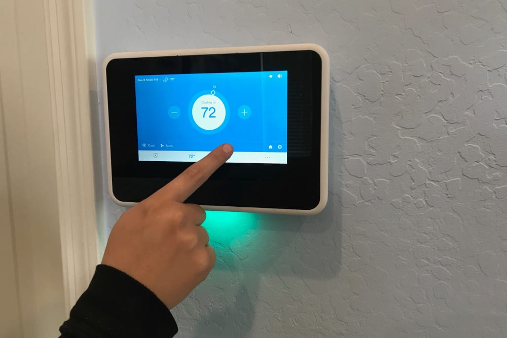 Digital thermostat at Christopher Todd Communities On Happy Valley in Peoria, Arizona