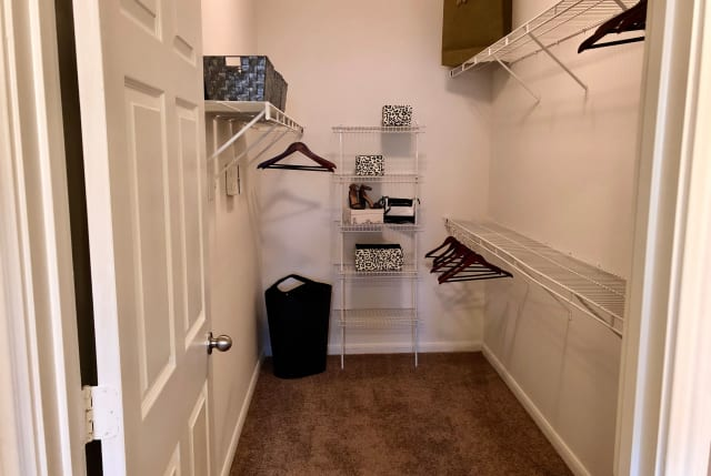 Primary closet at The Abbey on Lake Wyndemere in The Woodlands, TX