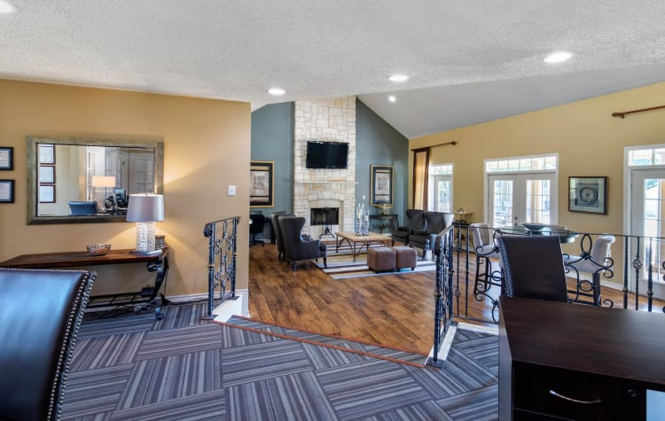 Spacious clubhouse with plenty of seating for entertaining guests at The Logan in Bedford, Texas