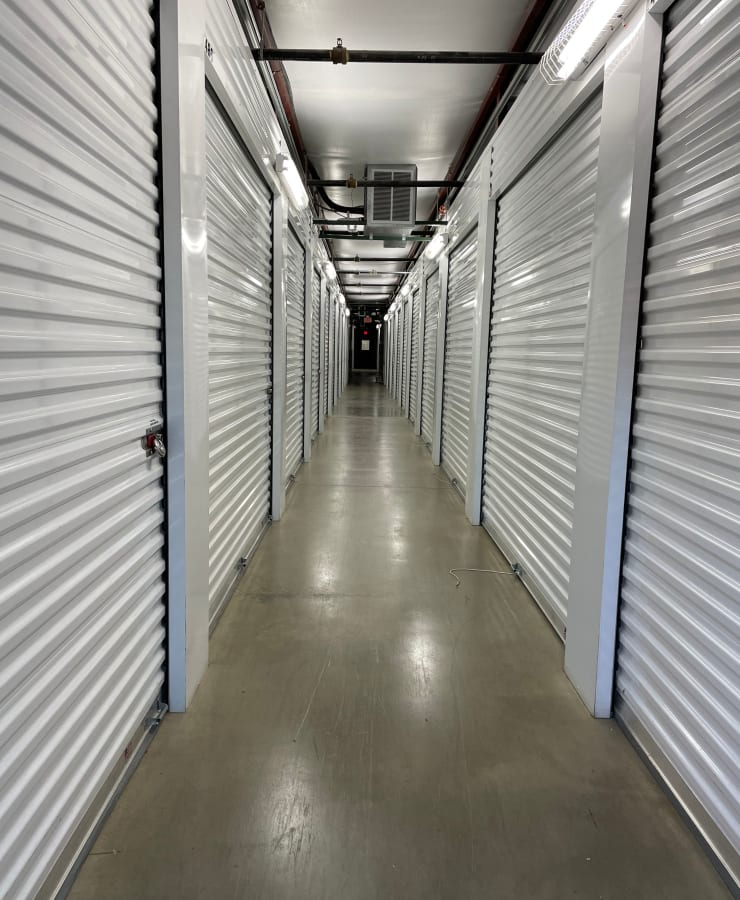 A hallway of indoor units with the doors closed at The Storage Place in Mesquite, Texas