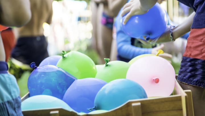 People playing with water balloons