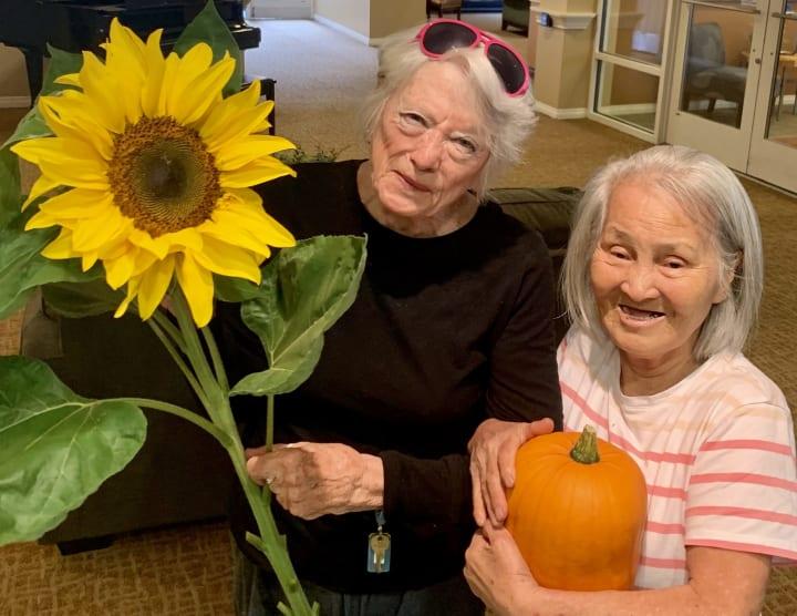 Residents enjoying their garden finds at Merrill Gardens at First Hill