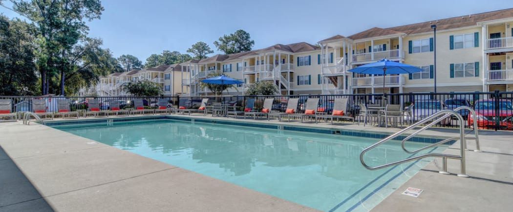 The sparkling swimming pool at The Park at Three Oaks in Wilmington is a great place to meet your new neighbors and make some new friends!