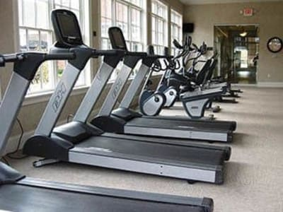 Well-equipped onsite fitness center at GrandeVille at Malta in Malta, New York