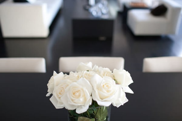 White roses and modern decor in an apartment at Cunard Apartments in Halifax, Nova Scotia.