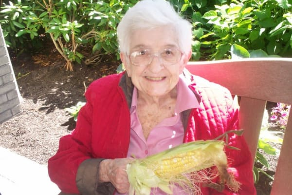 A resident with corn on the cob at Meadowlark Estates Gracious Retirement Living in Lawrence, Kansas