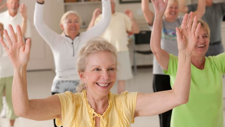 Smiling senior enjoying their yoga class.