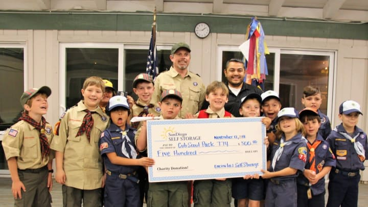 Encinitas Self Storage presenting donation to Cub Scout Pack 774