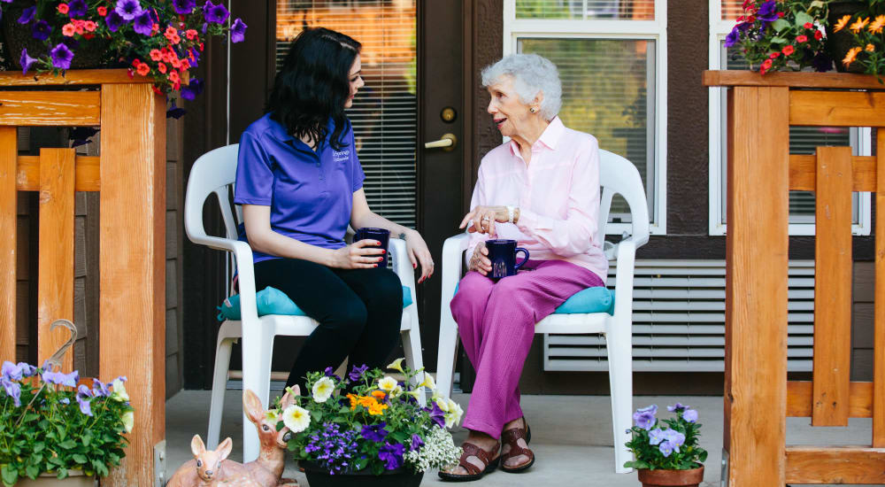 Resident enjoying coffee with a caregiver at The Springs at Missoula in Missoula, Montana
