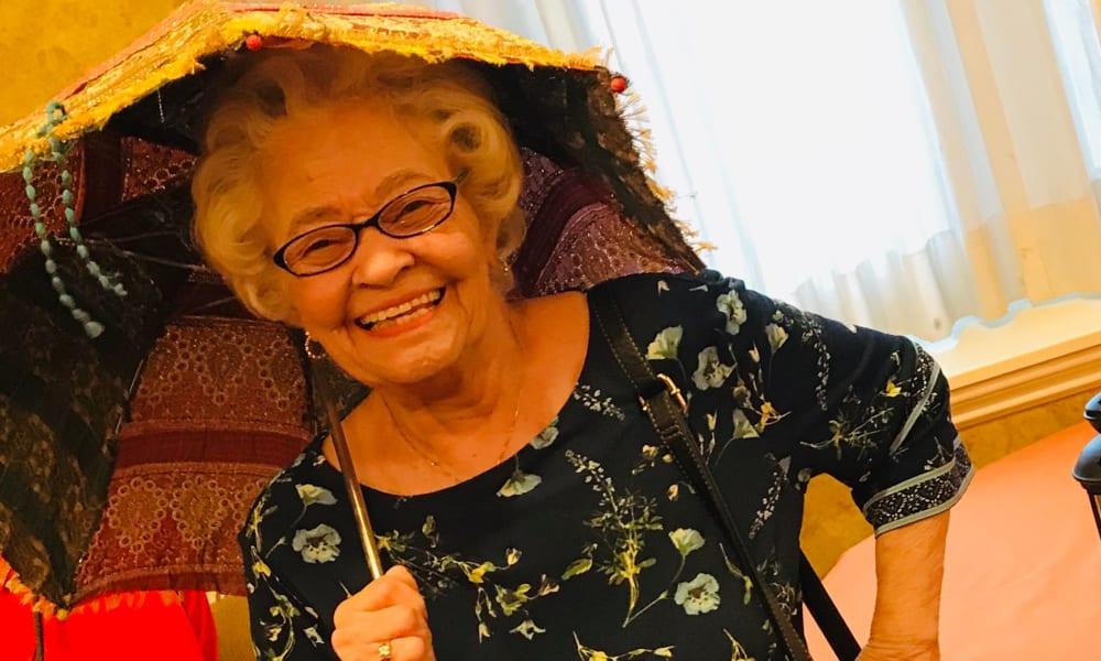 Senior  woman with umbrella at The Fair Oaks in Pasadena, CA