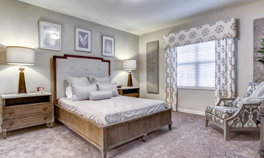 A furnished bedroom at The Oaks at Belmont in Belmont, Michigan
