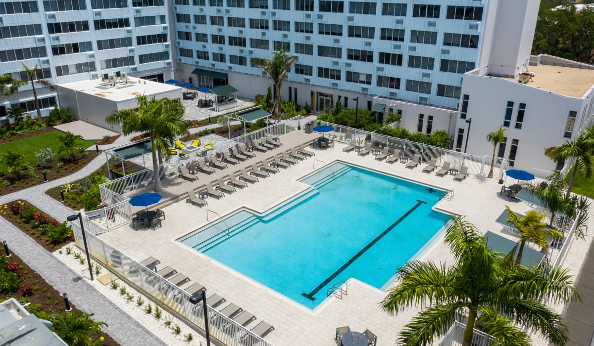 Outdoor swimming pool with relaxing pool side chairs at The Wayland in St Petersburg, Florida