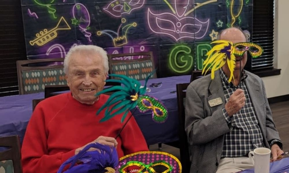 Two residents of Wilshire Estates Gracious Retirement Living in Silver Spring, Maryland celebrating Mardi Gras