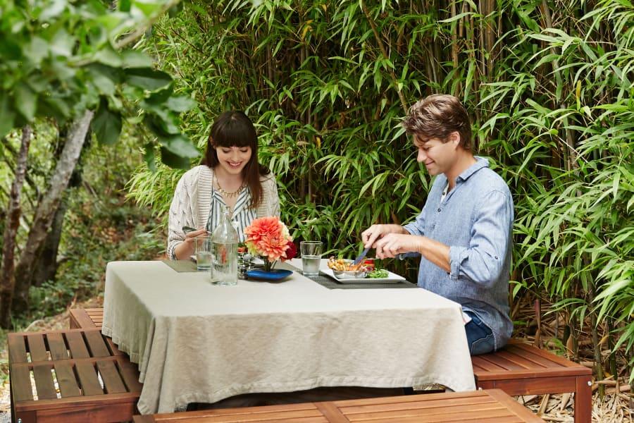 Resident couple sitting outside for a meal at their favorite restaurant near Sofi Irvine in Irvine, California