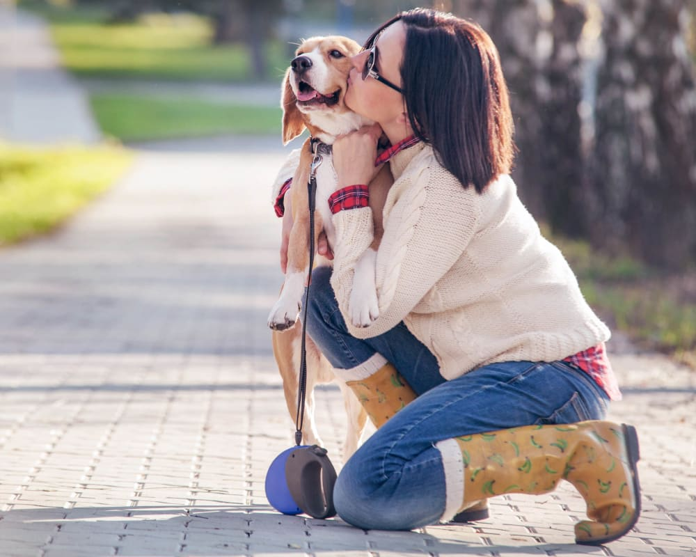 Resident and her dog stopping their walk for a kiss near Carrington Oaks in Buda, Texas