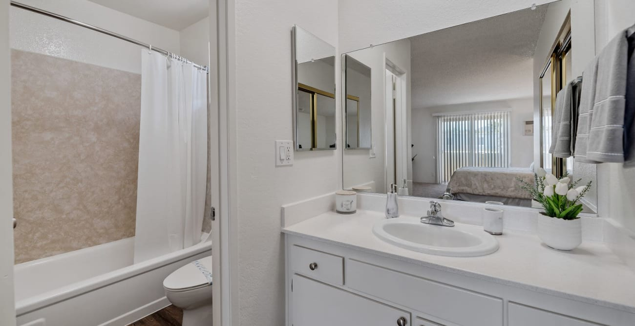 Bright bathroom with separate toilet and bathtub area at The Crossroads in Van Nuys, CA