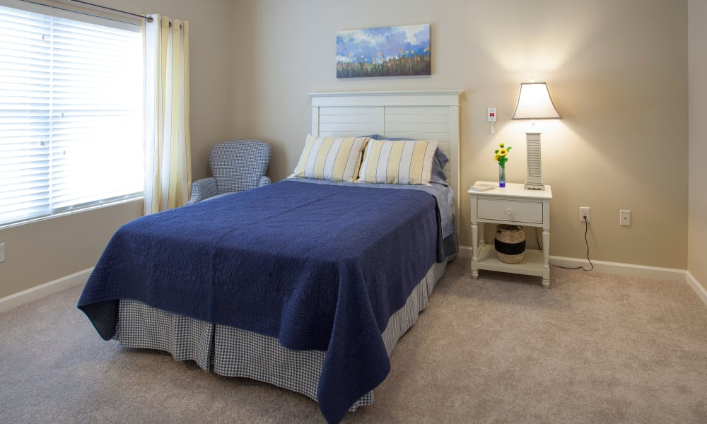 A large bedroom with furniture at Keystone Place at  Buzzards Bay in Buzzards Bay, Massachusetts