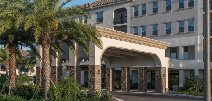 Front entrance with cover at Merrill Gardens at ChampionsGate