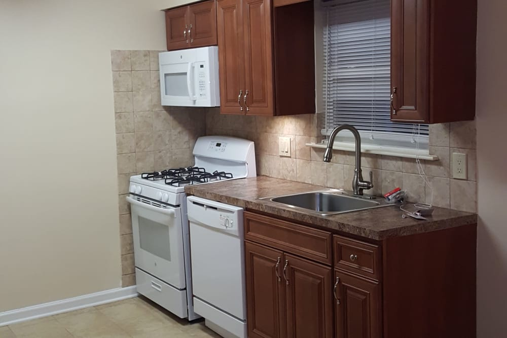 The kitchen and tall faucet at Wingate Apartments