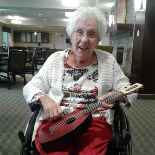 A resident plays music at First & Main of Lewis Center in Lewis Center, Ohio