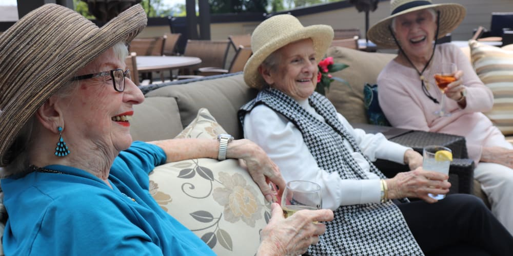 Residents enjoying drinks on the patio at The Springs at Carman Oaks in Lake Oswego, Oregon